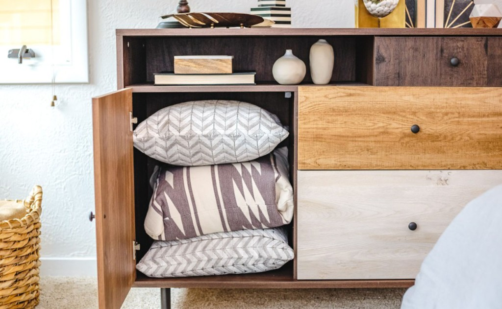 Door and cubby storage in Eden Rue Credenza bedroom storage