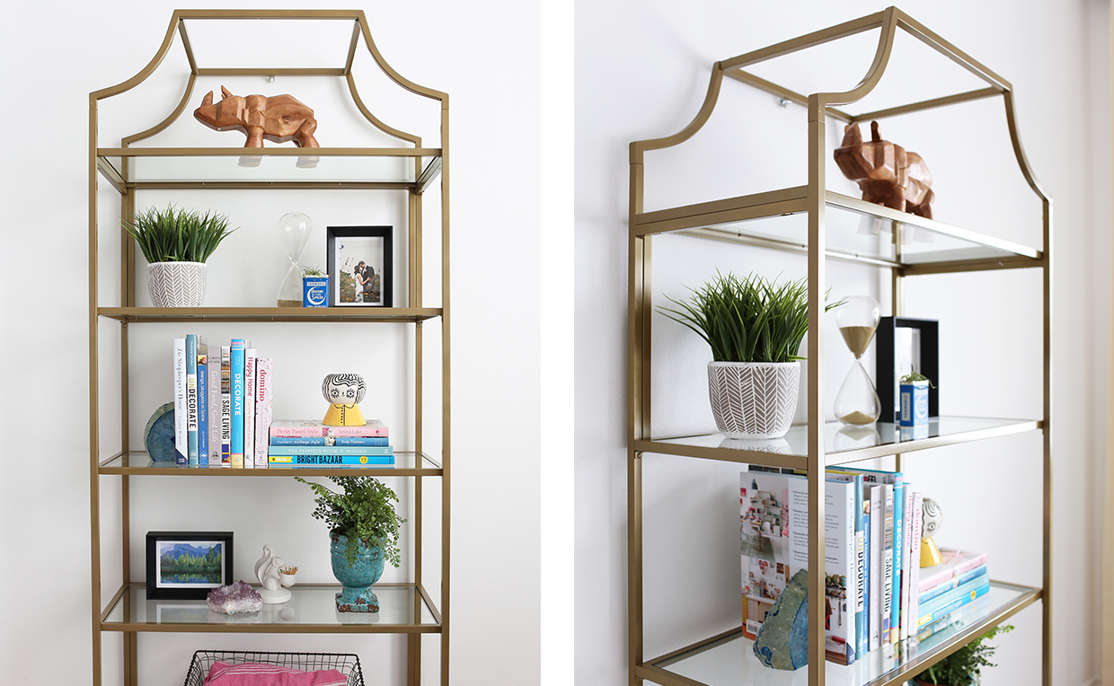 Gold metal and glass tower bookcase