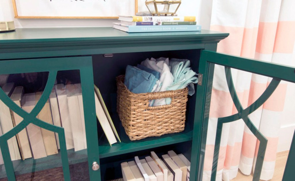 Emerald Green Shoal Creek Display Cabinet with books and bed linens behind doors