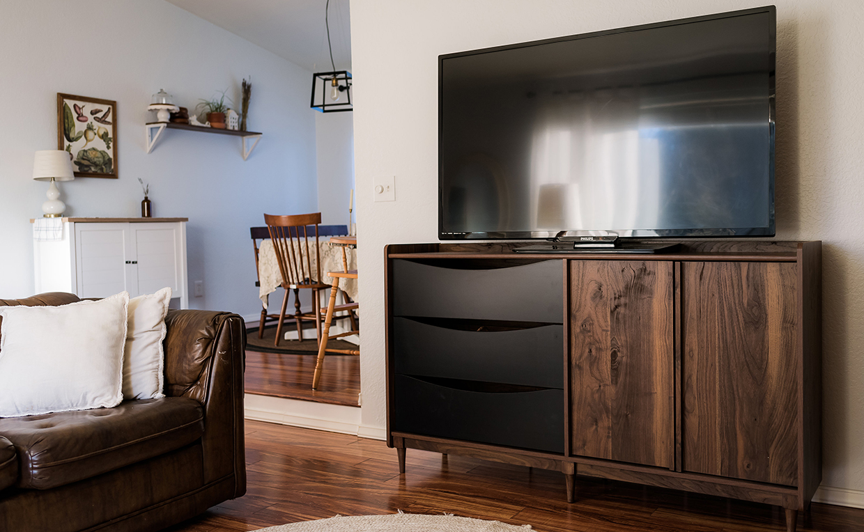 Midcentury Modern entertainment credenza with TV