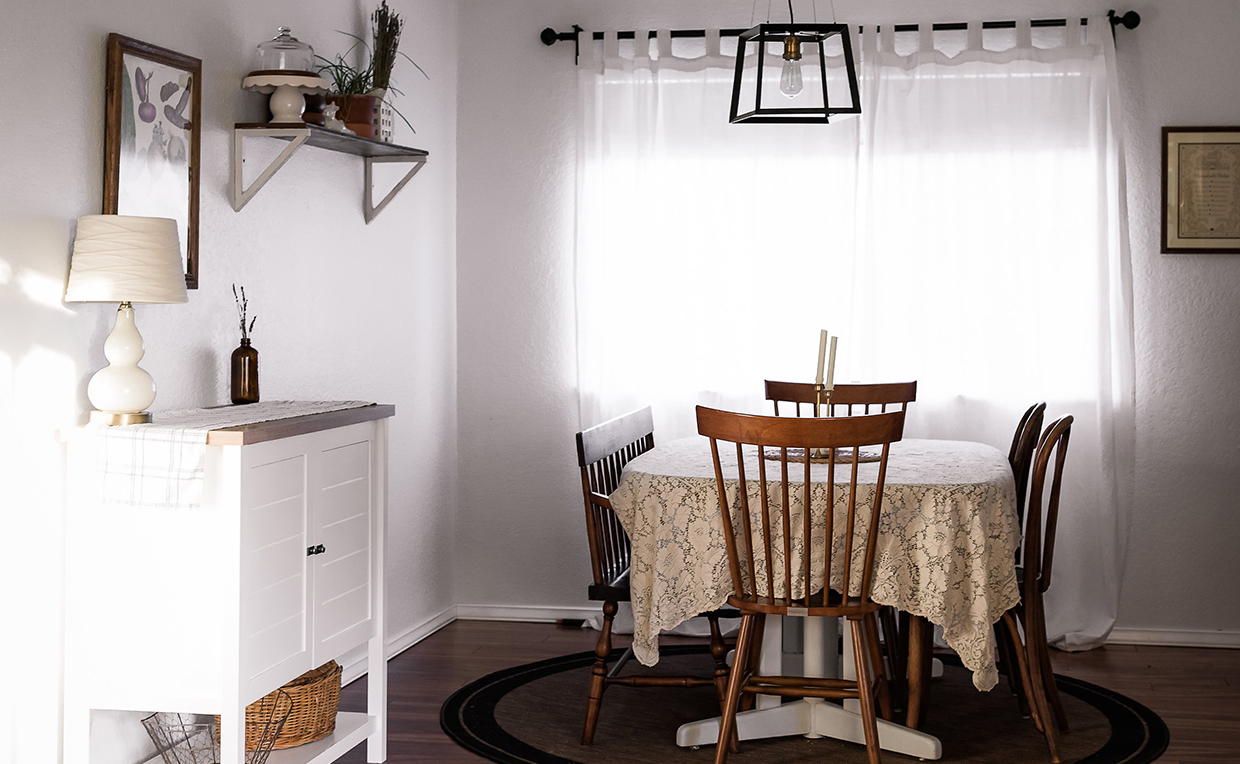 Dining area with cottage-style storage cabinet