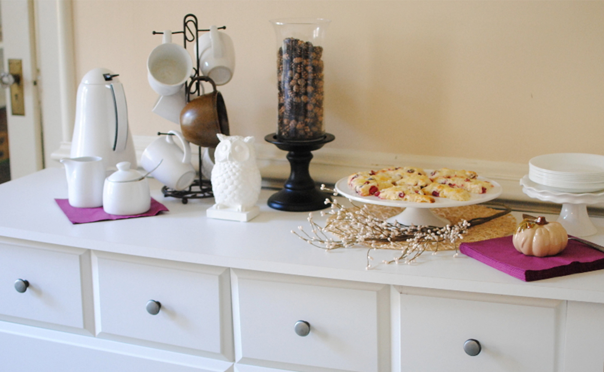 Use furniture for different purposes, like a dresser as a breakfast buffet.